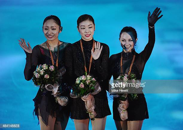 Miki Ando of Japan Yuna Kim of Republic of Korea and Elizaveta Tuktamysheva of Russia celebrate during the Medal Ceremony for the Ladies Free Skating...