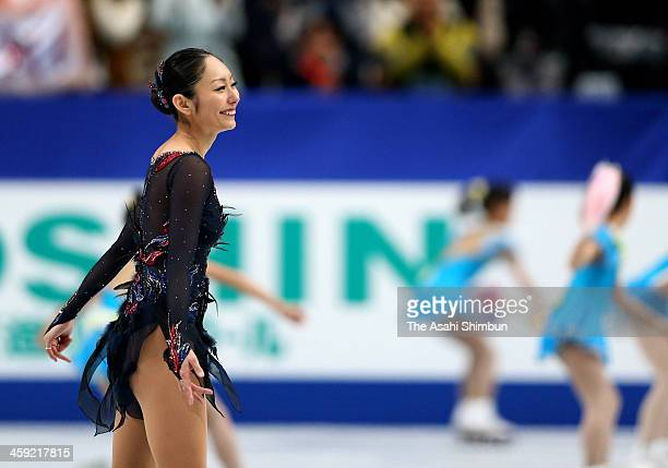 Miki Ando reacts after competing in the Ladies Singles free program during the 82nd All Japan Figure Skating Championships at Saitama Super Arena on...