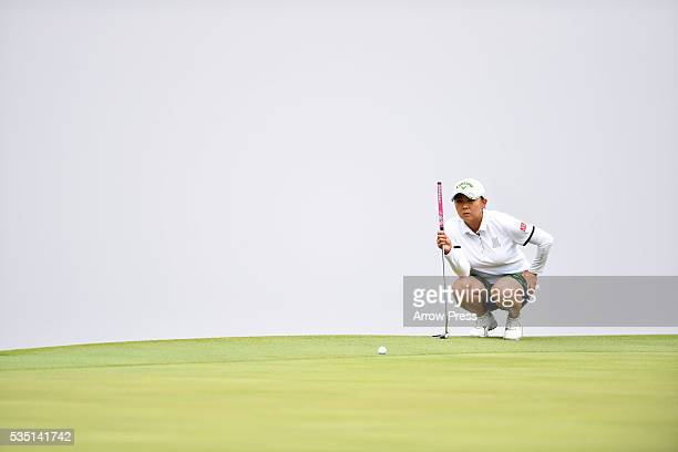 Miki Saiki of Japan lines up her putt on the 2nd green during the Final round of the Resorttrust Ladies at the Grandee Naruto Golf Club XIV on May 29...