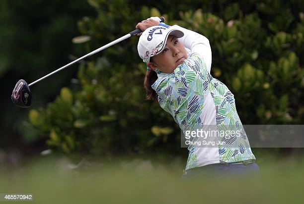Miki Saiki of Japan plays a tee shot during the final round of the Daikin Orchid Ladies Golf Tournament at the Ryukyu Golf Club on March 8 2015 in...