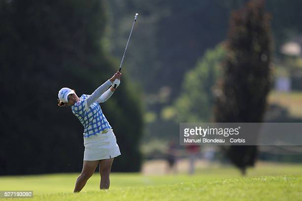 Miki Saiki of Japan plays her approach shot on the sixth hole during the final round of the 2010 Evian Masters on July 25 2010 in Evian France Photo...