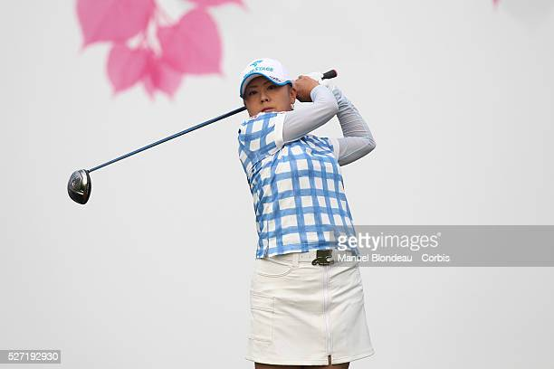 Miki Saiki of Japan plays her tee shot at the first hole during the final round of the 2010 Evian Masters on July 25 2010 in Evian France Photo...