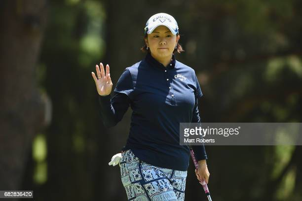 Miki Saiki of Japan reacts after her putt on the 14th green during the final round of the HokennoMadoguchi Ladies at the Fukuoka Country Club Wajiro...
