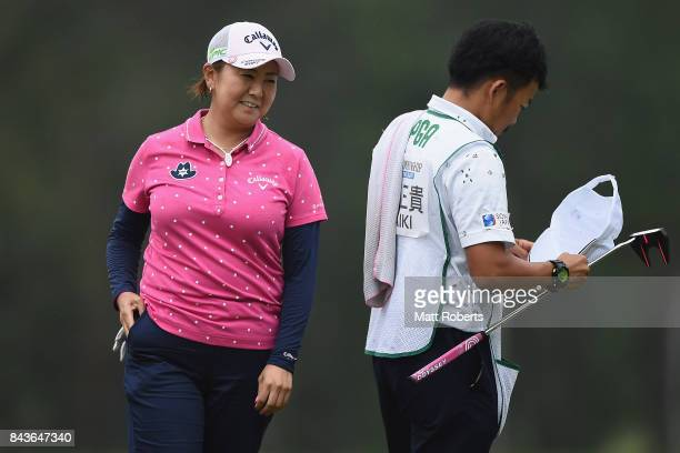 Miki Saiki of Japan smiles on the 18th green during the first round of the 50th LPGA Championship Konica Minolta Cup 2017 at the Appi Kogen Golf Club...