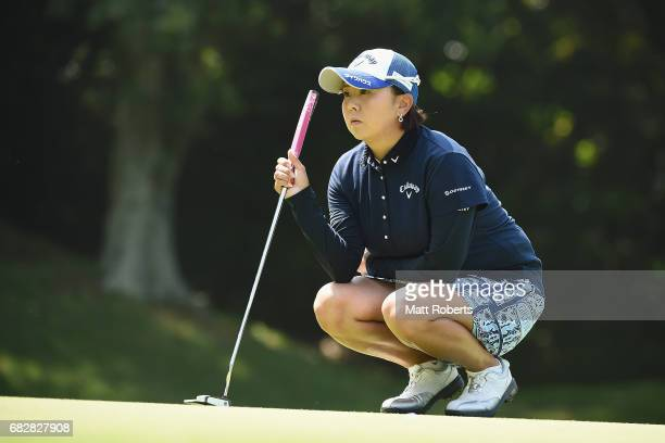 Miki Saiki of Japan waits to putt on the 6th green during the final round of the HokennoMadoguchi Ladies at the Fukuoka Country Club Wajiro Course on...