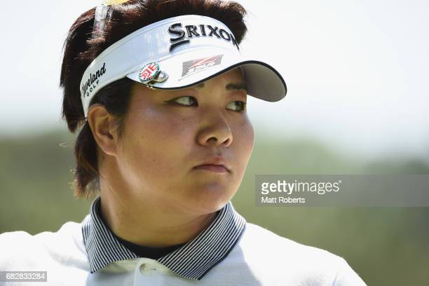 Miki Sakai of Japan looks on aftre her putt on the 8th green during the final round of the HokennoMadoguchi Ladies at the Fukuoka Country Club Wajiro...