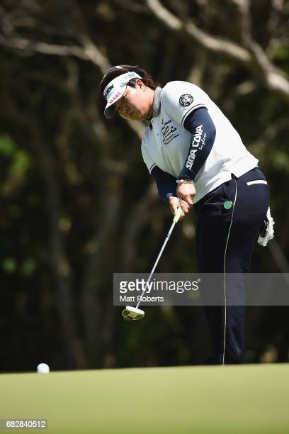 Miki Sakai of Japan putts on the 17th green during the final round of the HokennoMadoguchi Ladies at the Fukuoka Country Club Wajiro Course on May 14...
