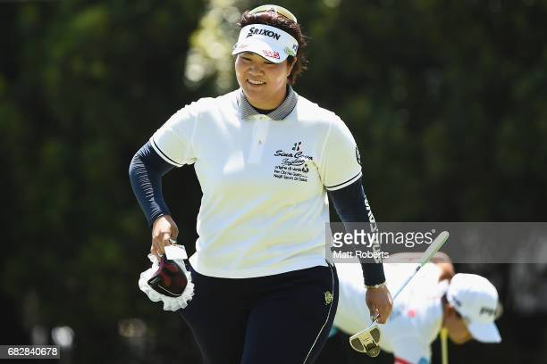 Miki Sakai of Japan smiles after her putt on the 18th green during the final round of the HokennoMadoguchi Ladies at the Fukuoka Country Club Wajiro...