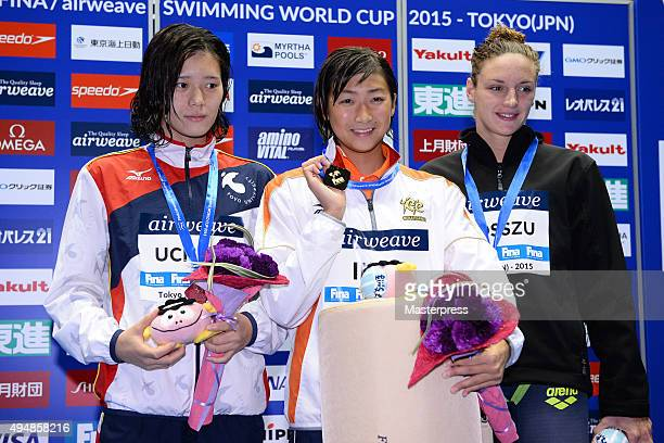 Miki Uchida of Japan Rikako Ikee of Japan and Katinka Hosszu of Hungary pose on the podium after the Women's 100m Freestyle final during the FINA...