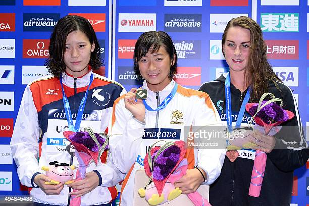 Miki Uchida of JapanRikako Ikee of Japan and Jessica Hobbin of Australia pose on the podium after the Women's 50m Butterfly final during the FINA...