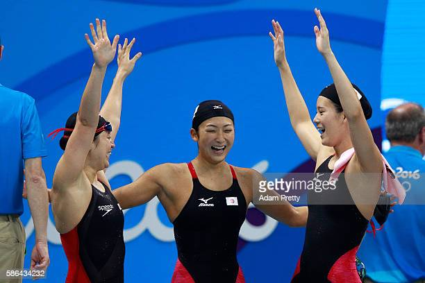 Miki Uchida Rikako Ikee and Misaki Yamaguchi of Japan celebrate in heat one of the Women's 4x100m Freestyle Relay on Day 1 of the Rio 2016 Olympic...