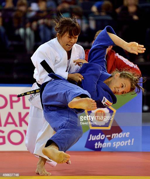 Miki Watanabe of Japan sweeps Maria Ertl of Germany to the mat for a yuko to reach the u52kg final and fight for the gold medal during the Glasgow...