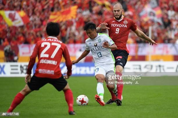 Miki Yamane of Shonan Bellmare and Robin Simovic of Nagoya Grampus compete for the ball during the JLeague J2 match between Nagoya Grampus and Shonan...