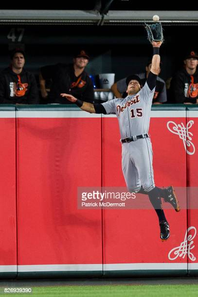 Mikie Mahtook of the Detroit Tigers catches a fly ball hit by Jonathan Schoop of the Baltimore Orioles in the eighth inning during a game at Oriole...