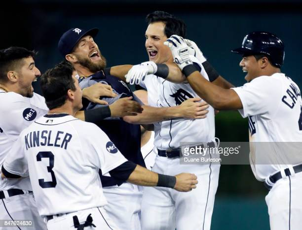 Mikie Mahtook of the Detroit Tigers celebrates with Nicholas Castellanos of the Detroit Tigers Ian Kinsler of the Detroit Tigers Shane Greene of the...