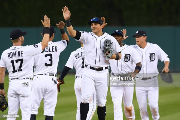 Mikie Mahtook of the Detroit Tigers gets highfives from teammates after the victory against the Houston Astros at Comerica Park on July 29 2017 in...