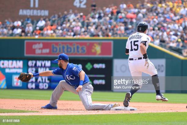 Mikie Mahtook of the Detroit Tigers is safe at first base as Eric Hosmer of the Kansas City Royals reaches for the throw during the game at Comerica...
