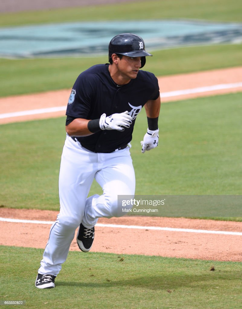 Mikie Mahtook #15 of the Detroit Tigers runs to first base during the Spring Training game against the New York Mets at Publix Field at Joker Marchant Stadium on March 12, 2017 in Lakeland, Florida. The Tigers defeated the Mets 4-3.