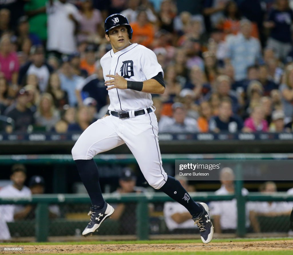 Mikie Mahtook #15 of the Detroit Tigers scores against the San Francisco Giants on a sacrifice fly hit by Nicholas Castellanos of the Detroit Tigers during the seventh inning at Comerica Park on July 5, 2017 in Detroit, Michigan. The Giants defeated the Tigers 5-4.