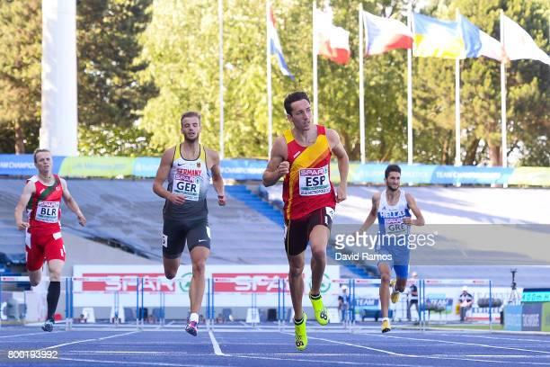 Mikita Yakauleu of Belarus Felix Franz of Germany Sergio Fernandez of Spain and Konstadinos Nakos of Greece compete in the Men's 400m Heat 2 Hurdles...