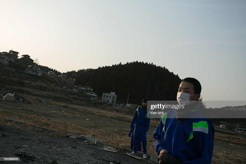 Mikito Sato, whose home was destroyed by the 2011 tsunami, plays catch with friends in the coastal town of Minamisanriku, that was 95 percent destroyed by the tsunami that followed the 2011 9.0 magnitude earthquake, March 9, 2013 in Minamisanriku, Miyagi prefecture, Japan. On March 11 Japan is to commemorate second anniversary of Magnitude 9.0 earthquake and following tsunami, that claimed more than 18,000 lives.
