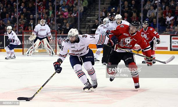 Mikkel Aagaard of the Niagara IceDogs battles with Bradley Latour of the Oshawa Generals during Game 4 of the Eastern Conference SemiFinals at the...