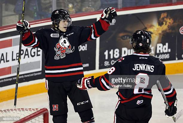 Mikkel Aagaard of the Niagara IceDogs celebrates his 3rd goal with Billy Jenkins during an OHL game against the Ottawa 67's at the Meridian Centre on...