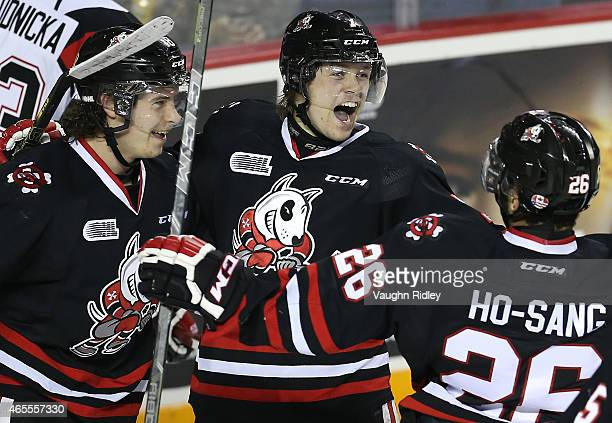Mikkel Aagaard of the Niagara IceDogs celebrates his 3rd goal with Billy Jenkins and Josh HoSang during an OHL game against the Ottawa 67's at the...