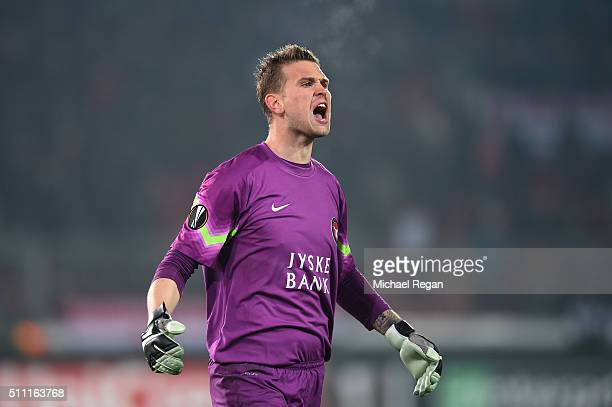 Mikkel Andersen of FC Midtjylland looks on during the UEFA Europa League round of 32 first leg match between FC Midtjylland and Manchester United at...