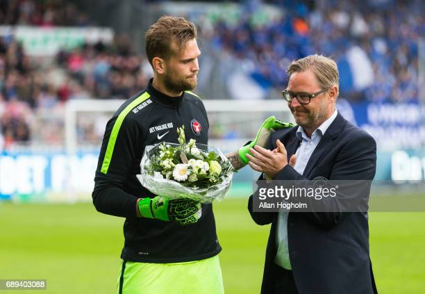 Mikkel Andersen of FC Midtjylland receiving flowers prior to the Danish Alka Superliga match between FC Midtjylland and Lyngby BK at MCH Arena on May...