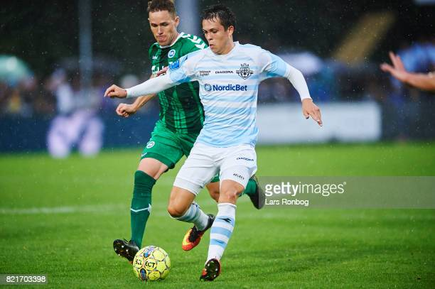 Mikkel Basse of FC Helsingor and Anders K Jacobsen of OB Odense compete for the ball during the Danish Alka Superliga match between FC Helsingor and...