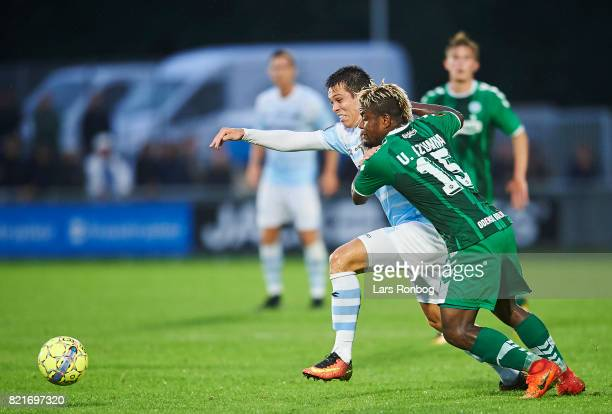 Mikkel Basse of FC Helsingor and Izunna Uzochukwu of OB Odense compete for the ball during the Danish Alka Superliga match between FC Helsingor and...