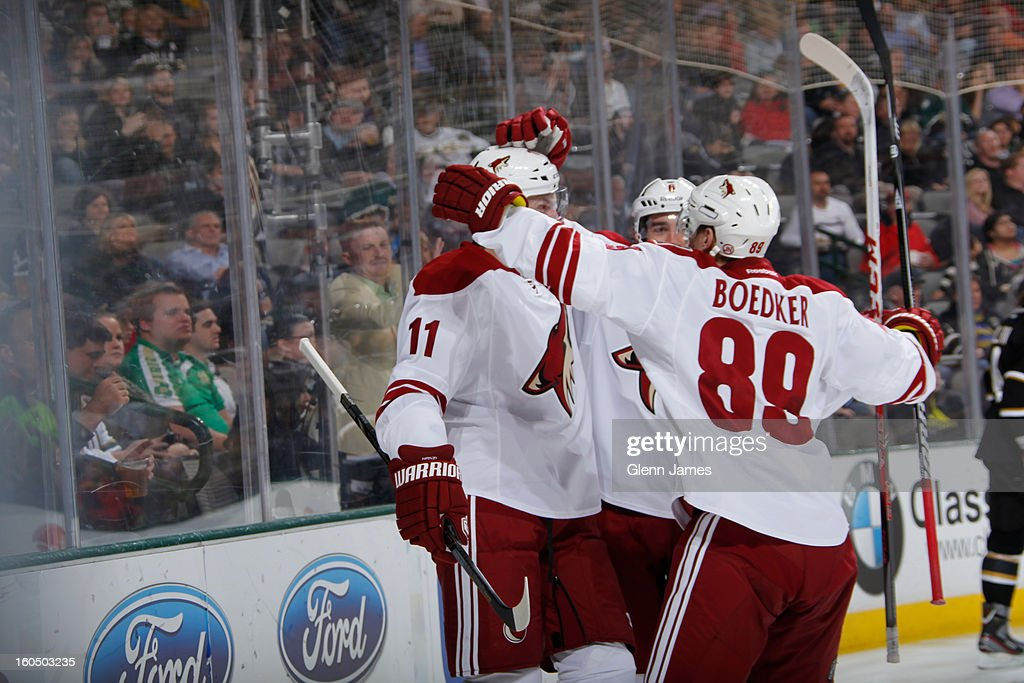 Mikkel Boedker #88 and Martin Hanzal #11 of the Phoenix Coyotes celebrate a goal against the Dallas Stars at the American Airlines Center on February 1, 2013 in Dallas, Texas.