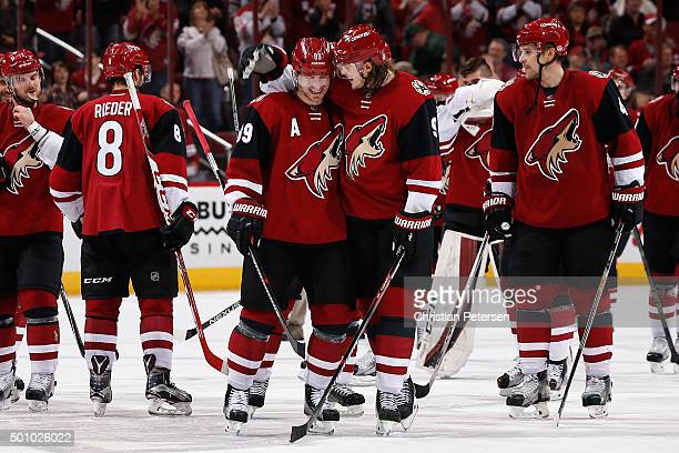 Mikkel Boedker and Viktor Tikhonov of the Arizona Coyotes celebrate after Boedker scored the game winning overtime power play goal against the...