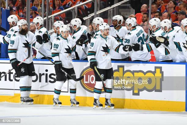 Mikkel Boedker Marcus Sorensen and Brent Burns of the San Jose Sharks celebrate after a goal in Game Five of the Western Conference First Round...