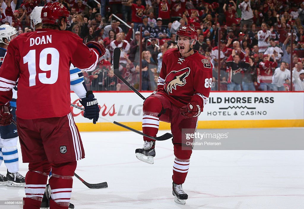 Mikkel Boedker of the Arizona Coyotes celebrates with Shane Doan after Boedker scored a first period goal against the Winnipeg Jets during the NHL...