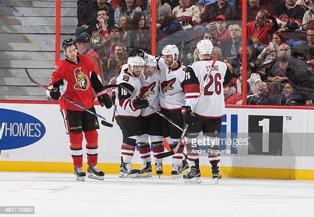 Mikkel Boedker of the Arizona Coyotes his second goal of the night with teammates Max Domi Kyle Chipchura and Michael Stone as Mark Stone of the...