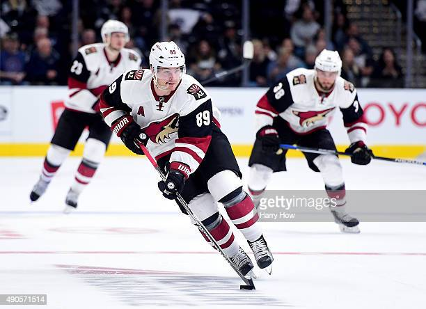 Mikkel Boedker of the Arizona Coyotes rushes with the puck with Lucas Lessio and Oliver EkmanLarsson during a preseason game against the Los Angeles...