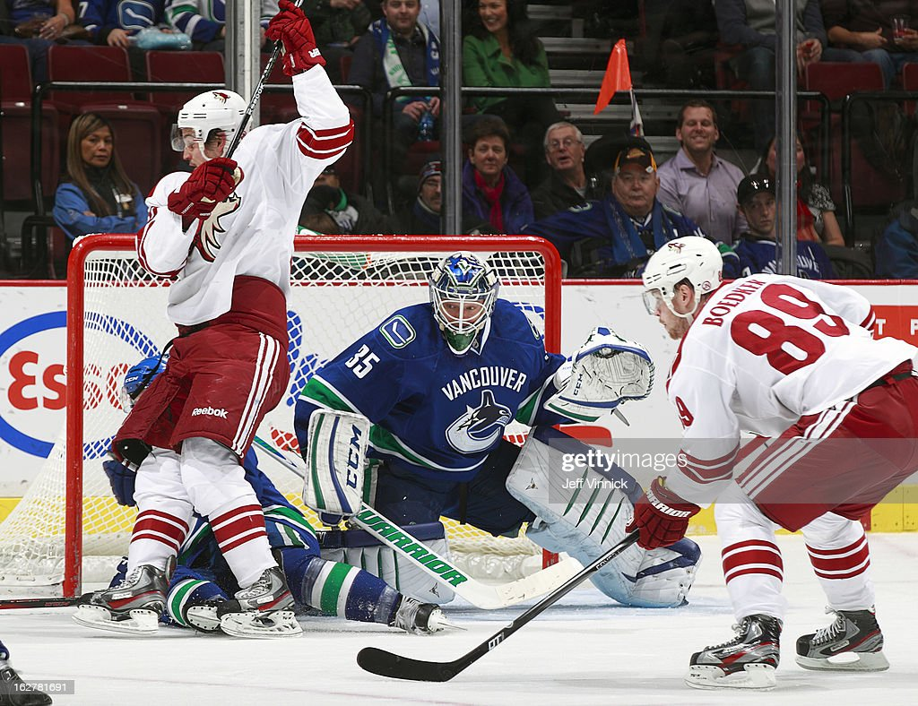 Mikkel Boedker #89 of the Phoenix Coyotes and Cory Schneider #35 of the Vancouver Canucks search for the puck in a crowded goal crease during their NHL game at Rogers Arena February 26, 2013 in Vancouver, British Columbia, Canada.