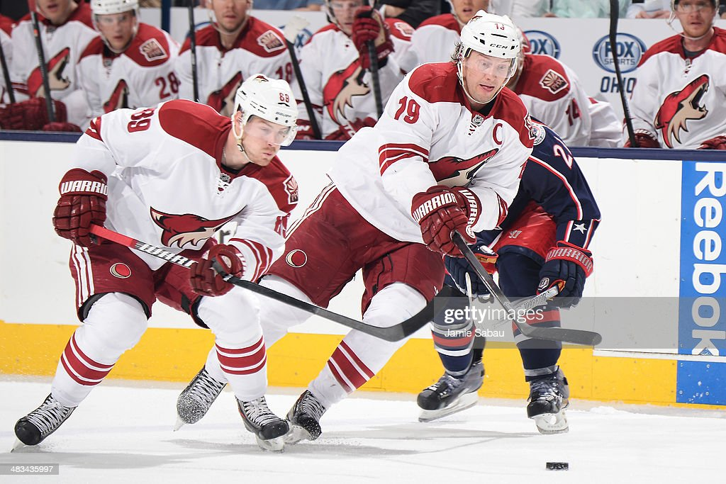 Mikkel Boedker #89 of the Phoenix Coyotes and Shane Doan #19 of the Phoenix Coyotes skate after a loose puck during the second period of a game against the Columbus Blue Jackets on April 8, 2014 at Nationwide Arena in Columbus, Ohio.