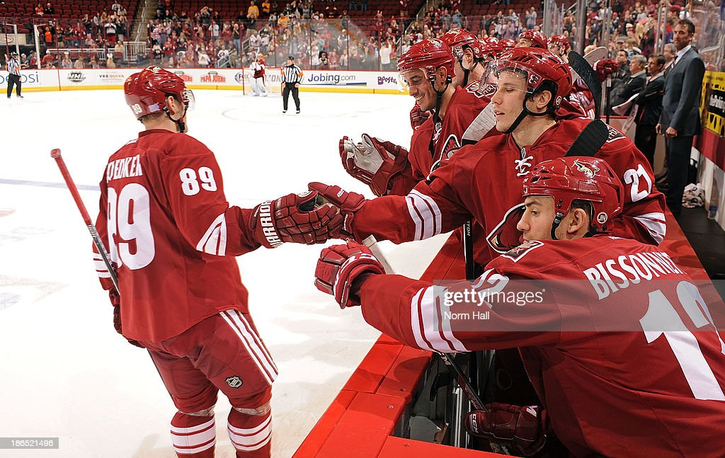 <a gi-track='captionPersonalityLinkClicked' href=/galleries/search?phrase=Mikkel+Boedker&family=editorial&specificpeople=4697252 ng-click='$event.stopPropagation()'>Mikkel Boedker</a> #89 of the Phoenix Coyotes and teammates <a gi-track='captionPersonalityLinkClicked' href=/galleries/search?phrase=Paul+Bissonnette&family=editorial&specificpeople=2235151 ng-click='$event.stopPropagation()'>Paul Bissonnette</a> #12, <a gi-track='captionPersonalityLinkClicked' href=/galleries/search?phrase=Andy+Miele&family=editorial&specificpeople=5807726 ng-click='$event.stopPropagation()'>Andy Miele</a> #21 and <a gi-track='captionPersonalityLinkClicked' href=/galleries/search?phrase=Mike+Ribeiro&family=editorial&specificpeople=203275 ng-click='$event.stopPropagation()'>Mike Ribeiro</a> #63 celebrate his game winning shootout goal against the Nashville Predators at Jobing.com Arena on October 31, 2013 in Glendale, Arizona.