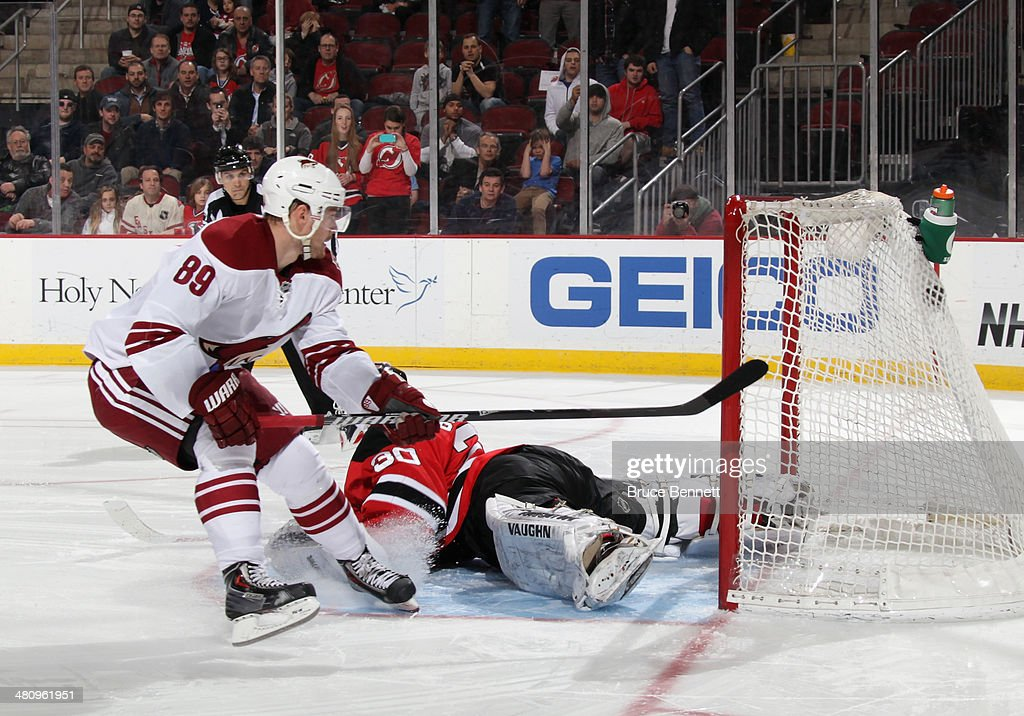 Mikkel Boedker of the Phoenix Coyotes scores past Martin Brodeur of the New Jersey Devils in the shootout at the Prudential Center on March 27 2014...