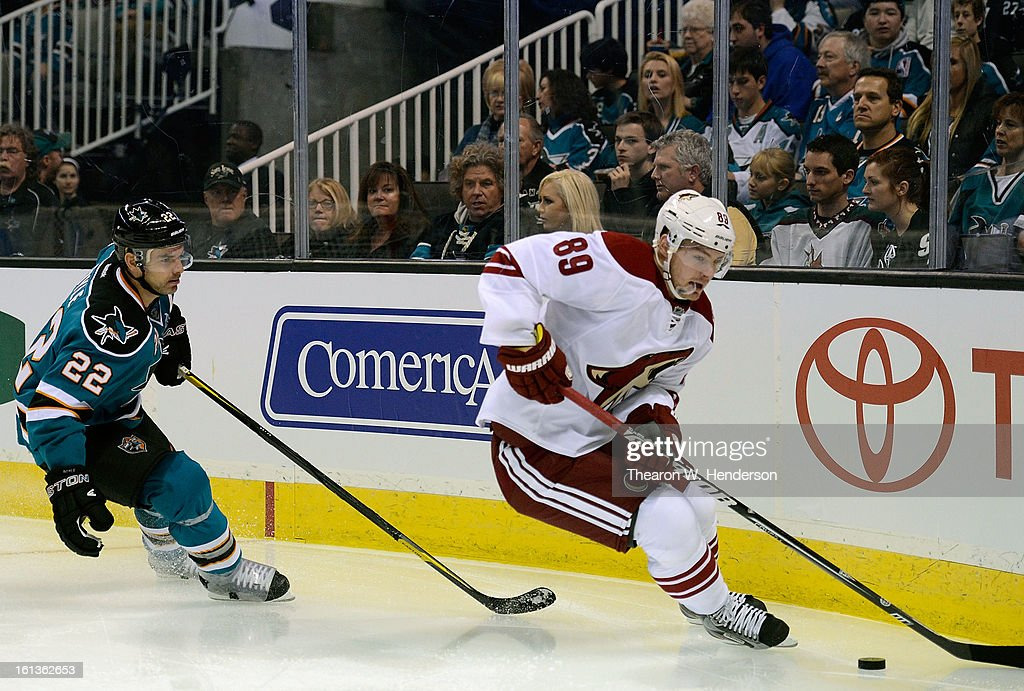 Mikkel Boedker #89 of the Phoenix Coyotes skates with control of the pucks chased by Dan Boyle #22 of the San Jose Sharks at HP Pavilion on February 9, 2013 in San Jose, California.