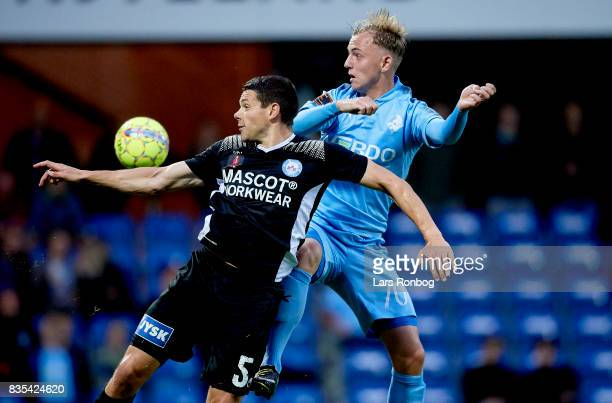 Mikkel Cramer of Silkeborg IF and Marcus Molvadgaard of Randers FC compete for the ball during the Danish Alka Superliga match between Randers FC and...