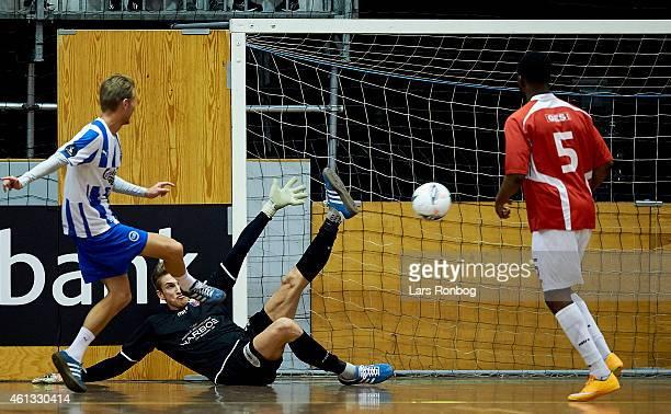 Mikkel Desler of OB Odense scores a goal against goalkeeper Frederik Schram of FC Vestsjalland during the Arbejdernes Landsbank Cup at Brondby Hallen...