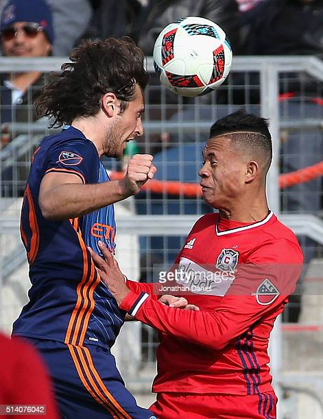 Mikkel Diskerud of New York City FC hads the ball over Rodrigo Ramos of Chicago Fire at Toyota Park on March 6 2016 in Bridgeview Illinois The New...