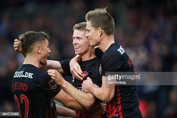 Mikkel Duelund Andre Romer and Jonas Borring of FC Midtjylland celebrate after scoring their second goal during the Danish Alka Superliga match...