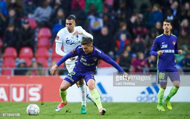 Mikkel Duelund of FC Midtjylland and Youssef Toutouh of FC Copenhagen compete for the ball during the Danish Alka Superliga match between FC...