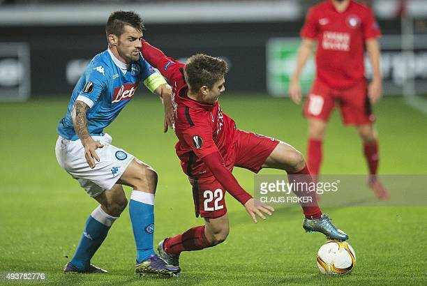 Mikkel Duelund of FC Midtjylland in action against Christian Maggio of Napoli during the UEFA Europa Leage football match FC Midtjylland v SSC Napoli...