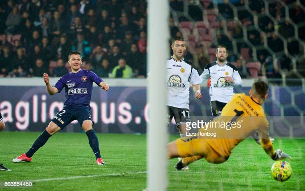 Mikkel Duelund of FC Midtjylland scores the 31 goal against Goalkeeper Jesse Joronen of AC Horsens during the Danish Alka Superliga match between FC...